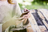 Woman's hands text messaging - FMKF05083