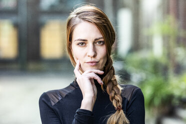 Portrait of serious woman with braid - FMKF05101