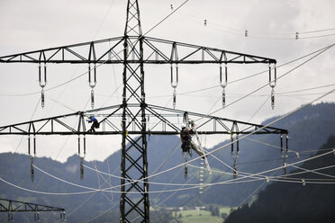 Installer during installation of high-voltage power line - CVF00700