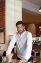 Portrait of mature man behind counter in cafe - ISF09162