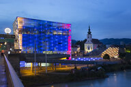 Austria, Linz, View of Lentos Art Museum, Danube river at blue hour - FC01411