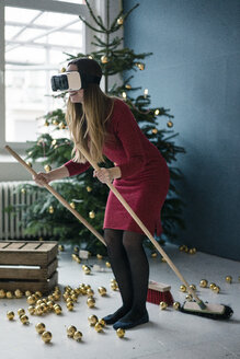 Woman using Virtual Reality Glasses at Christmas time - MOEF01376