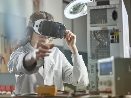 female engineer using virtual reality headset - CVF00702