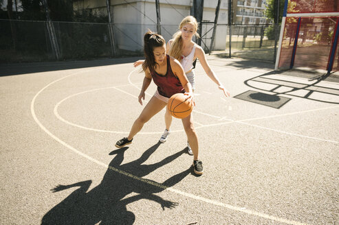 Two female basketball players practising on basketball court - CUF23179
