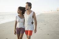 Romantic young couple strolling on beach, Cape Town, Western Cape, South Africa - CUF23209