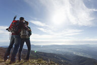 Hikers enjoying view from hilltop, Montseny, Barcelona, Catalonia, Spain - CUF23290