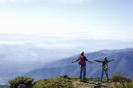 Hikers enjoying view from hilltop, Montseny, Barcelona, Catalonia, Spain - CUF23293
