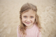 Little girl smiling on beach - CUF23427