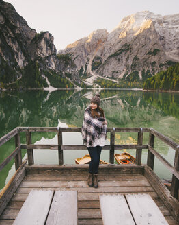 Woman leaning against wooden railings, Lago di Braies, Dolomite Alps, Val di Braies, South Tyrol, Italy - CUF23565