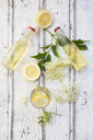 Homemade elderflower sirup, lemon slices, leaves and elderflower - LVF07039