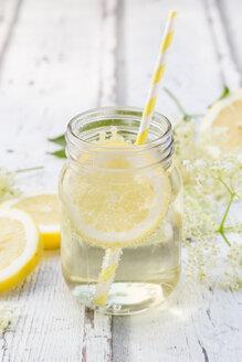 Glass of homemade elderflower sirup with slices of lemon - LVF07042