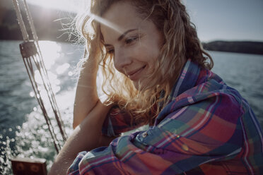 Portrait of smiling woman on a sailing boat - JLOF00025
