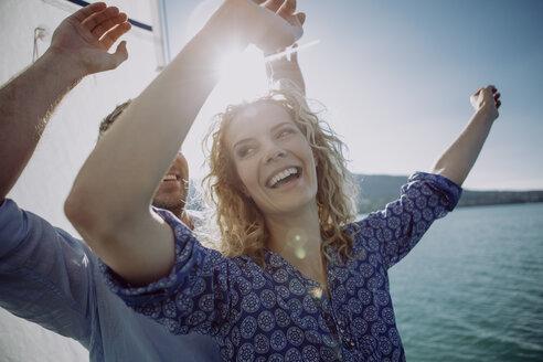 Happy couple on a sailing boat - JLOF00061
