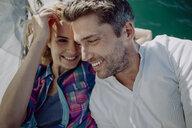 Happy couple on a sailing boat - JLOF00076
