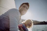 Happy couple on a sailing boat - JLOF00079