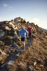 Trail runners on rocky path, Valais, Switzerland - CUF23900