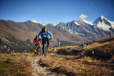 Mountain bikers on dirt track, Valais, Switzerland - CUF23906