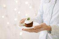Chocolate cupcakes topped with whipped cream - CUF24197