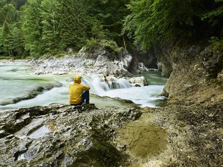 Austria, Tyrol, Brandenberg, hiker sitting on riverside of Brandenberger Ache - CVF00736