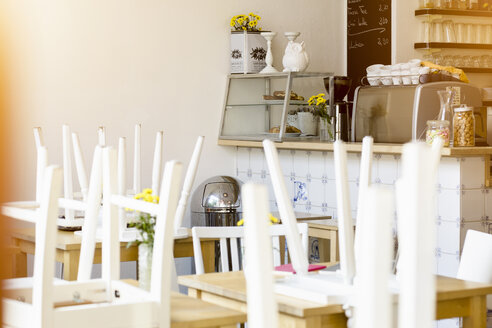 Cafe interior, closed, chairs on tables - CUF25673