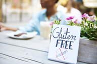 'Gluten free' sign at pavement cafe - ABIF00559