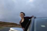 Woman leaning out of car window, Connemara, Ireland - CUF25962