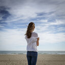 Rear view of mid adult woman looking out to sea, Castelldefels, Catalonia, Spain - CUF26061