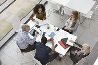 Overhead view of business team meeting at conference table - CUF26148