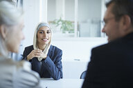 Over shoulder view of young businesswoman at interview in office - CUF26172