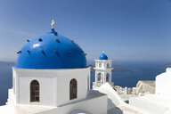 View of white washed church with blue domes, Oia, Santorini, Cyclades, Greece - CUF26241