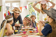 Parents and children laughing and chatting at kids birthday party - CUF26418