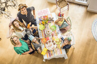 Overhead portrait of three generation family at kids birthday party - CUF26421