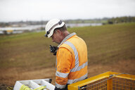 Engineer working at wind farm - CUF26505