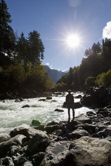 Rear view of male hiker looking out over river, Grindelwald, Switzerland - CUF26532