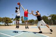 Three men practicing on basketball court - CUF26739