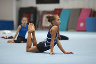 Young gymnasts practising moves - CUF26898