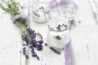 Glass of homemade lavender sugar with lavender blossoms - LVF07053