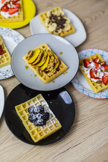 Plates of waffles with various toppings - GIOF03970