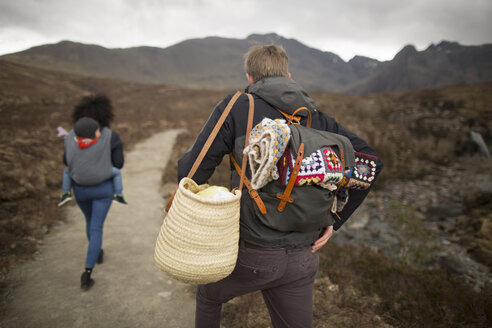 Family hiking on path, Fairy Pools, near Glenbrittle, Isle of Skye, Hebrides, Scotland - CUF27308