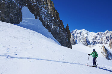 Mature male skier moving up Mont Blanc massif, Graian Alps, France - CUF27413