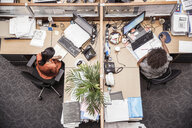 Overhead view of two businesswomen at office desk - CUF27900