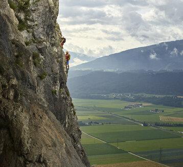 Austria, Tyrol, two rock climbers in Martinswand - CVF00752