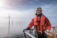 Portrait of engineer on boat at offshore windfarm - CUF28190