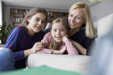 Mother and daughters having fun at home - RBF06275