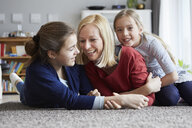 Happy mother and daughters having fun at home - RBF06284