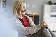 Happy woman relaxing at home - RBF06290