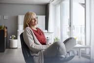 Happy woman relaxing at home - RBF06293