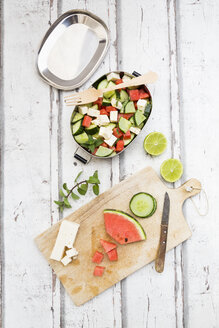Lunch box, preparation of watermelon salad with feta, cucumber, ment and lime dressing - LVF07067