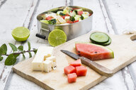 Lunch box, preparation of watermelon salad with feta, cucumber, ment and lime dressing - LVF07070