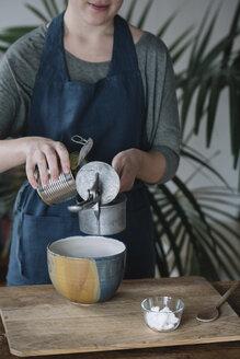 Woman preparing batter for homemade vegan chickpea cookies, partial view - ALBF00352